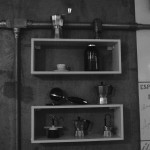 shelves of all sort of coffee related hardware