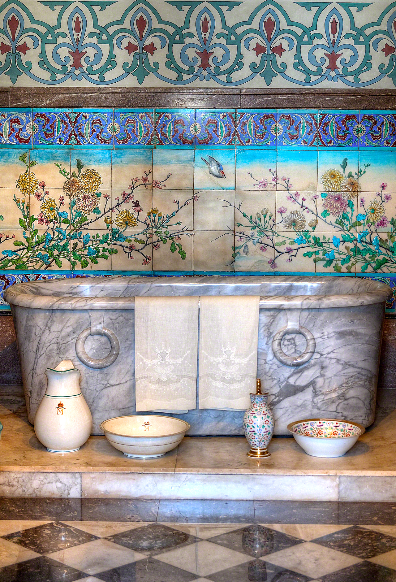 Marble bathtub and hand painted ceramic tiles