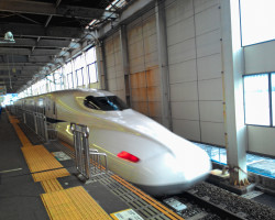 Train moving at high speed through station